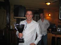 Andy Knights picking up the replacement League Cup on behalf of the team